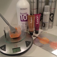 Using a scale and my favorite Redken colors to create test formulas