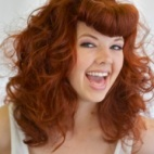 "First big change! RED! ""Awww this was our first photo shoot! I loved that color. We even went back to it later on, and I would definitely go red again in the future."""